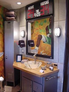A fun boys bathroom.  The counter top is from an actual basketball court.