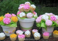 flower decorated cupcakes, presented as a bouquet :)