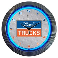 Neon lighting illuminates the face of this stylish Ford-themed wall clock, perfect for bringing bright retro-inspired appeal to your garage or game room....