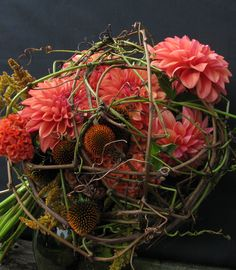 Fall brides bouquet for Crest Pavilion wedding. Asheville wedding flowers; all local dahlia, rudbeckia, celosia & amaranthus in vine cage. Designed by Janet Frye AIFD, The Enchanted Florist Asheville