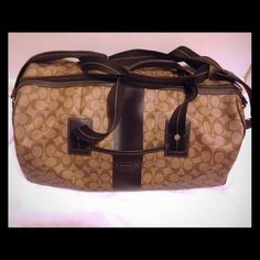 Authentic Coach Duffle Tan and chocolate duffle. Excellent for travel during the holiday seasons and very durable leather that can withstand rough airplane traveling. Coach Bags Travel Bags