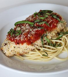 Cut Calories, Not Flavor: Baked Chicken Parmesan: Cooking spray 1 egg 1/2 cup unseasoned panko bread crumbs 1/4 cup grated parmesan cheese, plus 4 teaspoons 1 tablespoon Italian seasoning 1 teaspoon red pepper flakes 2 large chicken breasts (about 8 ounces each), cut in half 1/4 cup marinara sauce, either homemade or store-bought Fresh basil, for garnish