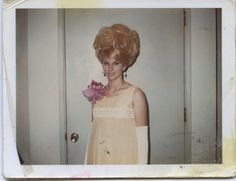 Sixties beehive hairdo and pale yellow prom dress.
