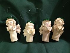 Noodle Angel Ornaments with green halos. $8.49, via Etsy.
