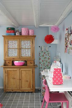 bead board ceiling and hanging pom poms, lovely cupboard with curtains? I would paint the cupboard instead, then the little curtains would pop!