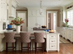 cool u-shaped layout. like kitchen cabinet color and stools.