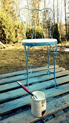 Metal garden chair from the 1940's painted with turquoise blue.
