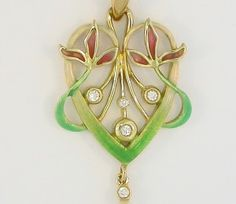 PENDANT: yellow gold, 4 diamonds 0,08 ct., 1 pearl and enamels. size: 24 x 50 mm. 02MP0031-1
