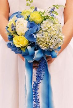 Weddbook is a content discovery engine mostly specialized on wedding concept. You can collect images, videos or articles you discovered  organize them, add your own ideas to your collections and share with other people - blue and yellow wedding bouquet