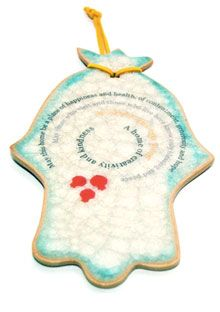 Israeli artist Michal Ben-Yosef handcrafts these ceramic hamsas to be blessings for the home. The text says,