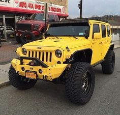 YELLOW JEEP WITH MODIFIED HOOD 4 IN LIFT FRONT BUMPER RIMS & LOVE THE DARK TINT