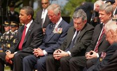 U.S. President Barack Obama  sits with (L-R) Prince Charles, The Prince of Wales, British Prime Minister Gordon Brown and Canadian Prime Minister Stephen Harper at the Normandy American Cemetery on June 6, 2009 in Colleville-sur-Mer, France. Political leaders and veterans are attending this international ceremony to commemorate the 65th anniversary of the D-Day landings on June 6, 1944.