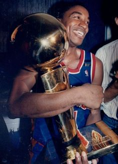 DEtroit Pistons' Isiah Thomas holds the trophy May 12, 1994. The Detroit News