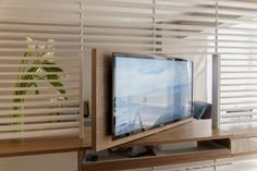 swivel stand for the flat-panel television. I think this is great, meaning only one TV is needed to serve both the living room and the bedroom.
