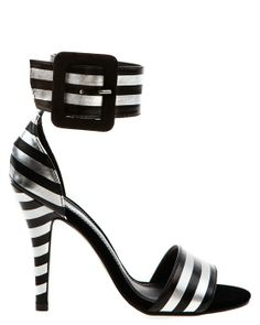 Silver and black striped sandals with a wide ancle strap and a big buckle.