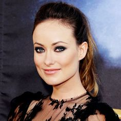 Olivia Wilde uses a smoky eye to add drama to her romantic look.