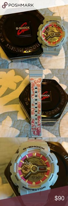 G-Shock watch VERY lightly used (handful of times). Super cute light baby blue with pink roses on the band. Pink accents on the face. No scratches or damage. Have original box and packaging. Battery works fine :)  Smoke free, dog friendly home. BUNDLE AND SAVE! G-Shock Accessories Watches