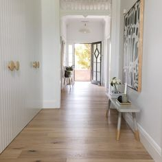 Clare Le Roy Adding big picture frame. Wood floor with white wall