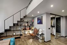 Making use of space under the stairs by turning it into a redaing nook with open bookshelves