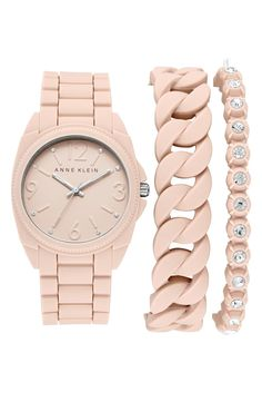 A sporty silicone watch paired with matching bracelets that make for a complete stacked wrist.