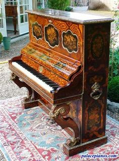Art Cased Upright Montal Piano serial number 795 - Year 1851Category: Art Case Pianos » Universal Exhibition Pianos A Gorgeously Decorated and inlaid upright piano made by Montal Paris 1851. This upright piano was displayed and won Montal an award medal the same year. The upright is made of numerous different types of fruit wood, and exotic woods. Flower and birds are inlaid all over the case on all sides followed by gilt bronzes.