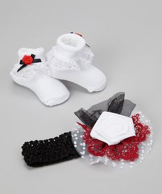Embellished with a rosette, tulle and lace, this stretchy crocheted headband combines with the matching socks to form head-to-feet charm. Packaged together in a clear box, this darling duo makes a perfect gift for new bundles of joy.Includes headband and socksHeadband: 14'' circumferenceFlower: 5'' wideHeadband: 100% nylonSocks: 78% cotton / 19% polyester / 3% elastaneImported