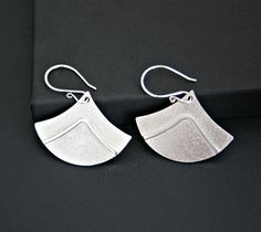 Modern Rounded Triangular Light Weight Geometric Design Dangle Earrings Sterling Silver Handmade A modern and softer rounded pair of geometric sterling silver earrings. I design and hand fabricate each pair of earrings including ear wires from solid sterling silver sheet and wire.  metal: sterling silver earring dimensions: 25 mm (1 inches) length 35mm (1.5 inch) width approx.  total earring length: 42 mm ( 1 3/4 inches approx.) from top of ear wire to bottom tip of earring.  My makers mark…