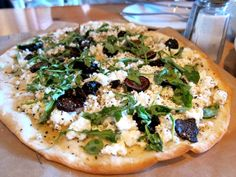 crispy flatbread, manouri cheese (or feta), dried mission figs, arugual, dried oregano. Drizzle with honey and extra virgin olive oil. (from Kentro Greek Kitchen, Fullerton, CA)