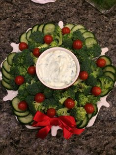 Broccoli, cucumber and tomato wreath for Tim's Work potluck!