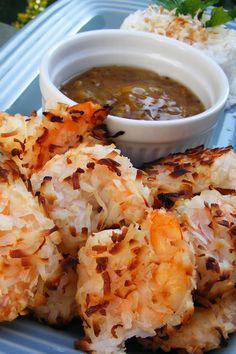 """""""This crunchy coconut shrimp is baked instead of fried, and so easy! Great for dinner or as an appetizer. I serve with orange marmalade for dipping."""" Ingredients 1 pound large shrimp, peeled and deveined cup Baked Coconut Shrimp, Coconut Shrimp Recipes, Fish Recipes, Seafood Recipes, Great Recipes, Dinner Recipes, Cooking Recipes, Favorite Recipes, Coconut Prawns"""
