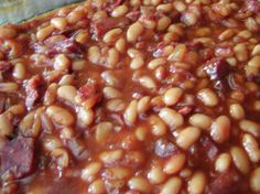 Hawaiian Baked Beans Recipe - Genius Kitchen Great for luaus, family gatherings, barbecues and other occasions where you have a few mouths to feed. Hawaiian Baked Beans, Hawaiian Dishes, Hawaiian Recipes, Hawaian Party, Hawaiian Luau Party, Aloha Party, Hawaiin Party Food, Hawaiian Theme Food, Tiki Party