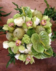 Tropical wedding flower Centerpiece with green cymbidiums and anthurium - (re) Pinned by www.westpointorchids.com
