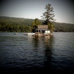 Newfound Lake, NH: This house is in the bay across from our summer place! I used to love going by this when I was little!