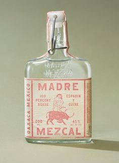 Madre Mezcal Branding & Packaging by LAND # Food and Drink logo bottle design Mockup Design, Font Design, Label Design, Typography Design, Web Design, Retro Typography, Bottle Packaging, Print Packaging, Product Packaging Design