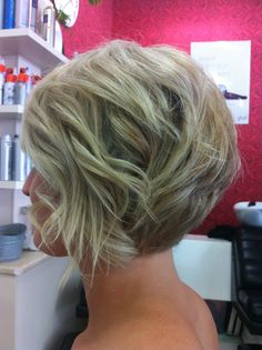 Concave textured bob with a few soft curls.