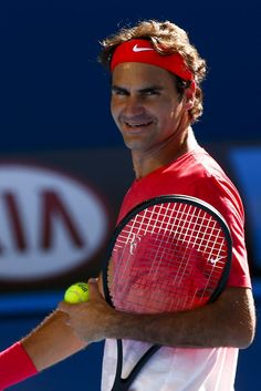 Roger Federer ~ all smiles during a practice session at the Australian Open 2014 tennis tournament in Melbourne