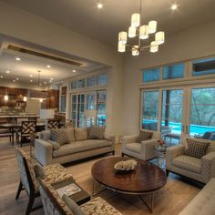 by Huestis Tucker Architects, LLC   Family room with vaulted ceiling, photo by Nancy Elizabeth Hill