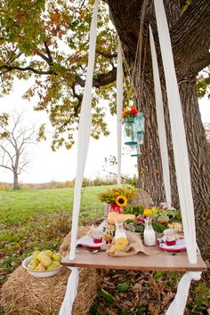 Gathered: Styled Events | Vintage Rentals    Vintage Farmers Market wedding  Old chippy paint door hung by sheets. Burlap. Produce and flowers centerpieces. Milk jars. Homemade jam favors.
