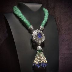 """Instagram media vancleefarpels - Van Cleef & Arpels Mirroir Enchanté necklace from the """"Peau d'Âne raconté par Van Cleef & Arpels"""" - white gold, diamonds, emeralds,  sapphires, white cultured pearls - on view at TEFAF Maastricht from March 11 to 20, 2016.  Inspired by the mirror that Peau d'Âne takes with her in her flight, the necklace is adorned with a rare Burmese sapphire weighing 24.77 carats, of a deep and intense blue.#VCApeaudane #HighJewelry #TEFAF2016"""