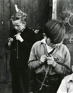 Two boys preparing for a game of conkers in Addison Place, W11, 1957. By Roger Mayne. S)