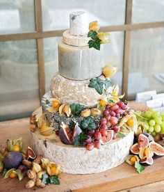 "Why have a cheese plate when you can have a cheese ""cake""? The couple even made sure to provide bags so their guests could take slices of cheese home with them! photo: @dominiquebaderphotography, venue: #thebabingtonhouse by @sohohouse #snippetandink #meaningfulwedding"