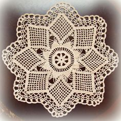 This lovely doily is made in such a nice pattern. Worked in ecru (natural color) crochet thread, open-worked diamonds form the petals of a beautiful star flower. A pretty scalloped edge finishes off the whole. Measuring just over 15 across from point to point, its a beauty, just