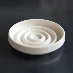Concentric Soap Dish by Pigeon Toe Ceramics \\\ $36  Shallow, hand-thrown dish with a graphic, circular pattern to keep soap dry.