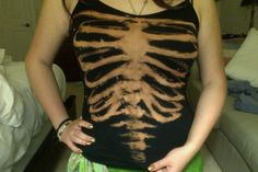 Bleach Print Skeleton Shirt. Clever idea. Seems easy enough from reading the directions. Only thing is there is no template for the skeleton. You'd have to draw one yourself. This would be awesome for Halloween time.