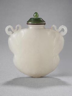 Snuff Bottle and Stopper Pilgrim's Bottle Shape; Leaves Artist/maker unknown, Chinese Qing Dynasty (1644-1911) 1644-1911 Made of White Jade