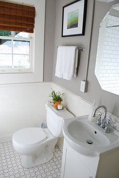 LOVE this gray bathroom paint on the white subway tile.   Note: Grey grout hides dirt
