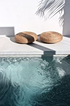outdoor living | pool | white walls | rattan pouffs