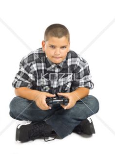 concentrated boy - A boy who is concentrating on a video game
