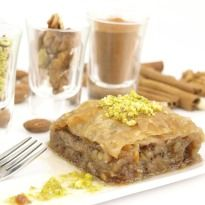 #Baklava: A flaky pastry with cinnamon flavored nuts layered between sheets and soaked in sugar syrup.