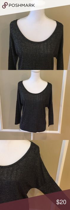 NWT American Eagle Outfitters top NWT black/grey AEO hi/low top.  Size medium.  68% viscose 28% polyester 4% elastane. Stylish and comfortable! American Eagle Outfitters Tops